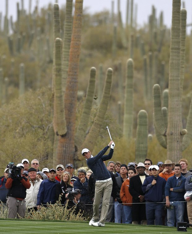Martin Kaymer of Germany tees off on 8 while playing Bubba Watson during the semifinals of the Match Play Championship golf tournament Saturday, Feb. 26, 2011, in Marana, Ariz.