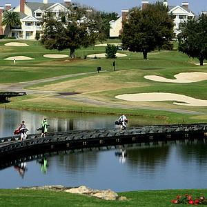 Players in Golfweek's Spring Invitational walk across the bridge at No. 7.