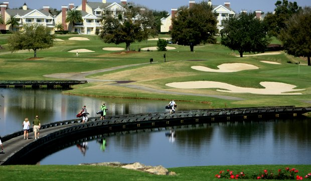 Players in Golfweek's Spring Invitational walk across the bridge at No. 7.