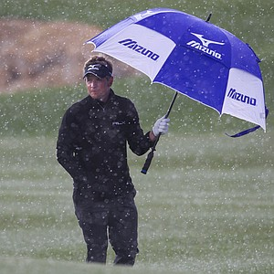 Luke Donald of England walks along the fourth fairway as snow falls while playing Martin Kaymer in the finals of the Match Play Championship golf tournament Sunday, Feb. 27, 2011, in Marana, Ariz.