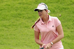 Paula Creamer of the USA reacts to a birdie putt on the 12th hole during the final round of the HSBC Women's Champions 2011 at the Tanah Merah Country Club on February 27, 2011 in Singapore, Singapore.