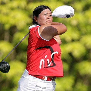Christina Kim of the USA loses her cap as she hits her tee shot on the sixth tee during the final round of the HSBC Women's Champions at Tanah Merah Country Club on February 27, 2011 in Singapore, Singapore.