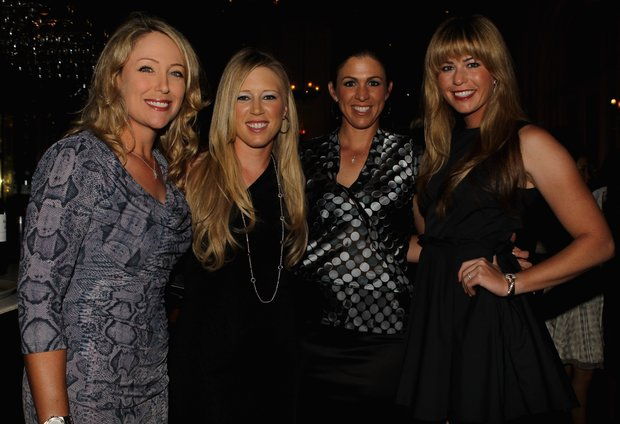 Cristie Kerr, Morgan Pressel, Nicole Castrale and Paula Creamer (all of the USA) pose for a photograph during the Welcome Reception prior to the start of the HSBC Women's Champions at the Tanah Merah Country Club on February 23, 2011 in Singapore.