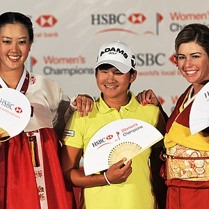 Taiwan golfer Yani Tseng, center, posing with US golfer Michelle Wie, left, dressed in a traditional Korean 'hanbok' and compatriot Paula Creamer, right, dressed in a traditional Japanese 'kimono' after a press conference ahead of this week's HSBC Women's Champions golf tournament in Singapore. Newly crowned world number one Yani Tseng has her eyes set on lifting a trophy for the fourth time in four weeks when the HSBC Women's Champions golf tournament tees off this week in Singapore.