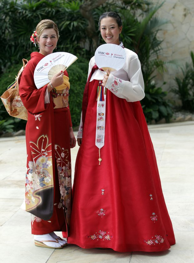 Paula Creamer and Michelle Wie in traditional Japanese and Korean dress during a photocall at the Fairmont Hotel prior to the HSBC Women's Champions at Tanah Merah Country Club on February 22, 2011 in Singapore, Singapore.