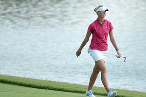 Jessica Korda of the USA walks to the eighth green during the final round of the HSBC Women's Champions 2011 at the Tanah Merah Country Club on February 27, 2011 in Singapore, Singapore.