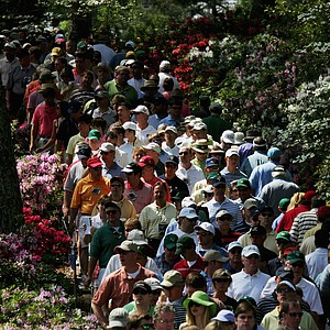 Patrons walk along the sixth hole during the second round of The Masters at the Augusta National Golf Club on April 7, 2006 in Augusta, Georgia.