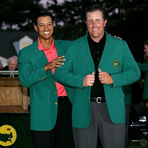 Tiger Woods and Phil Mickelson pose after Woods put the green jacket on Mickelson after winning The Masters at the Augusta National Golf Club after the final round on April 9, 2006 in Augusta, Georgia. Mickelson won with the score seven under.