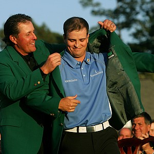 Phil Mickelson presents Zach Johnson with the Masters green jacket after Johnson's two-stroke victory at The Masters at the Augusta National Golf Club on April 8, 2007 in Augusta, Georgia.