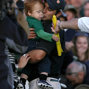 Trevor Immelman of South Africa kisses his son Jacob Immelman after winning the 2008 Masters Tournament at Augusta National Golf Club on April 13, 2008 in Augusta, Georgia.