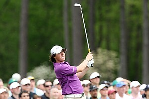 Rory McIlroy of Northern Ireland plays his tee shot on the 12th hole during the second round of the 2009 Masters Tournament at Augusta National Golf Club on April 10, 2009 in Augusta, Georgia.