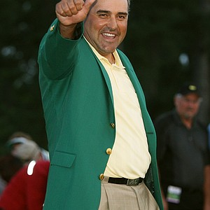 Angel Cabrera of Argentina celebrates during the green jacket presentation after defeating Kenny Perry on the second sudden death playoff hole to win the 2009 Masters Tournament at Augusta National Golf Club on April 12, 2009 in Augusta, Georgia.