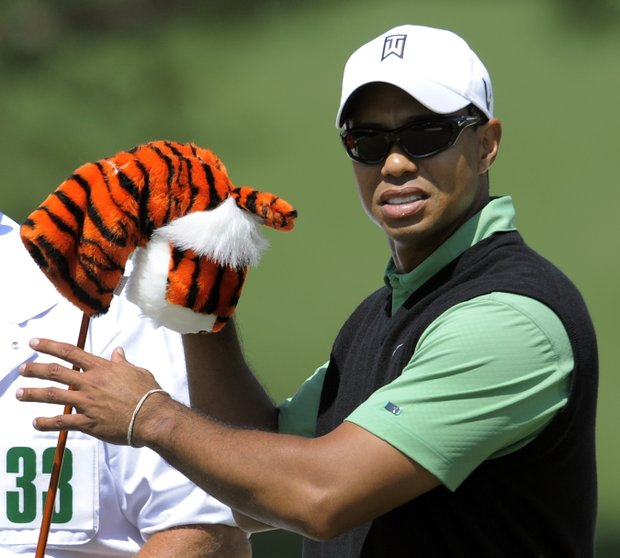 Tiger Woods of the US takes a club at the 7th hole hole during the 2nd round of the 2010 Masters Tournament at Augusta National Golf Club on April 9, 2010 in Augusta, Georgia.