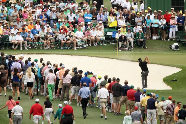 Phil Mickelson plays a shot from a bunker on the ninth hole in front of a gallery of fans during the first round of the 2010 Masters Tournament at Augusta National Golf Club on April 8, 2010 in Augusta, Georgia.