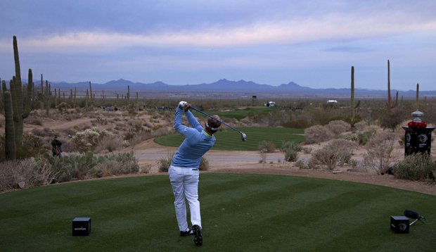 Luke Donald tees off on the first hole at the Ritz-Carlton Club at Dove Mountain in Marana, Ariz.