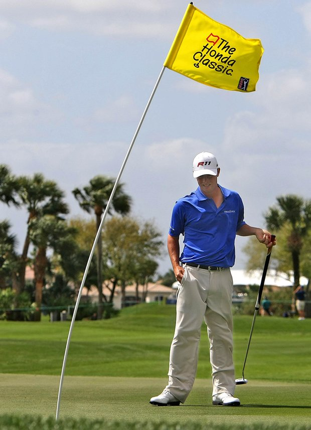 Spencer Levin surveys the eighteen green during first round action of the 2011 Honda Classic.
