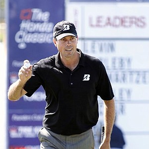 Matt Kuchar acknowledges the crowd after putting on the 18th hole during the second round of the Honda Classic.