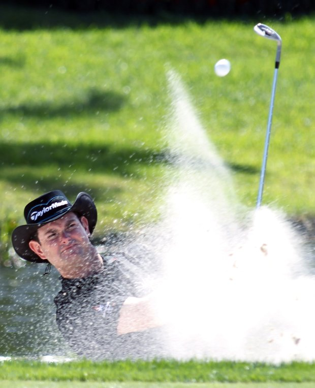 Rory Sabbatini of South Africa hits out of a bunker on the 16th hole during the second round of the Honda Classic.