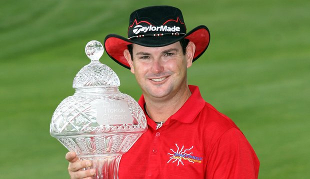 Rory Sabbatini poses with the trophy after winning The Honda Classic at PGA National Resort.
