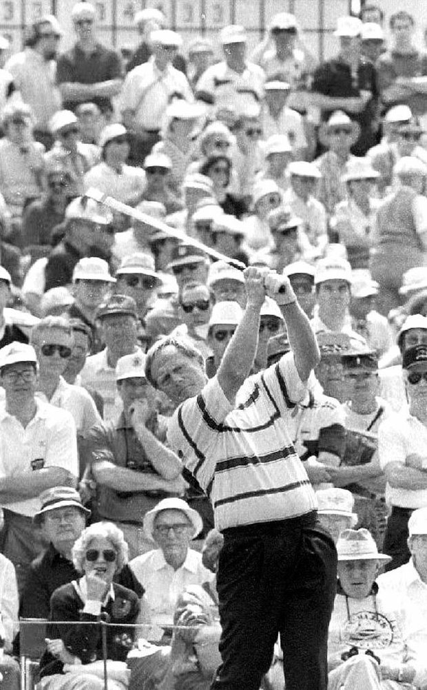 Jack Nicklaus of the U.S. tees-off on the third tee 09 April, 1992, as the crowd watches from the gallery at Augusta National Golf Club. Nicklaus is going for his seventh win at the Masters Tournament.