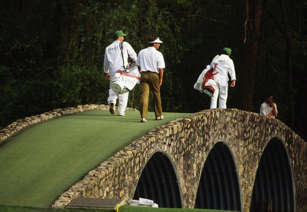 Fred Couples of USA crosses the Hogan bridge during the final round of the Masters, held at The Augusta National Golf Club on April 14, 1996 in Augusta, GA.
