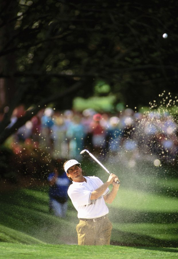 Fred Couples of USA plays out of a bunker on the 10th hole during the final round of the Masters, held at The Augusta National Golf Club on April 12, 1992 in Augusta, GA.