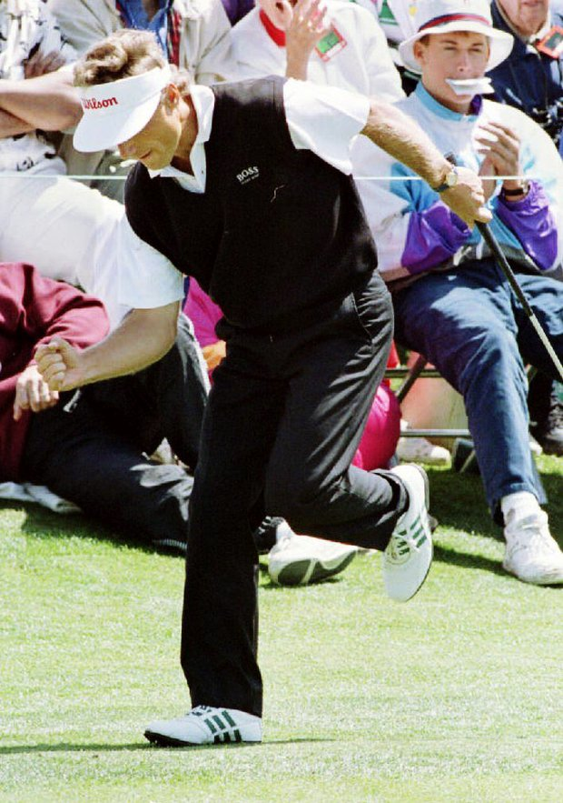 Bernhard Langer of Germany pumps his fist after making a birdie putt on the second green 10 April 1993 during third round action of the Masters Tournament. Langer took the lead at seven-under- par on the putt.