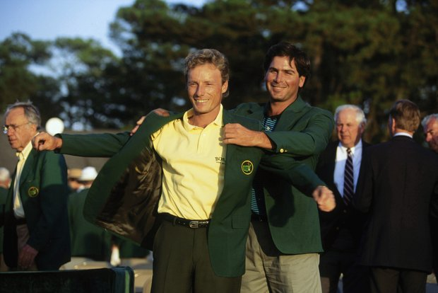 Bernhard Langer of Germany is presented with the green jacket by Fred Couples of USA after the final round of the Masters, held at The Augusta National Golf Club on April 11, 1993 in Augusta, Georgia.