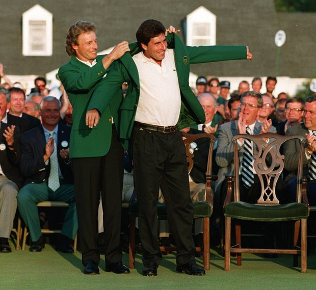 1993 US MASTERS CHAMPION BERNHARD LANGER OF GERMANY PUTS THE FAMOUS GREEN JACKET ON JOSE-MARIA OLAZABAL OF SPAIN AFTER HE BEAT TOM LEHMAN OF THE USA BY TWI STROKES IN THE FINAL ROUND OF THE 1994 US MASTERS AT THE AUGUSTA NATIONAL CLUB IN GEORGIA.