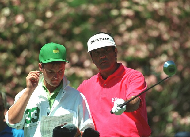 SEVE BALLESTEROS OF SPAIN DISCUSSES HIS OPTIONS WITH CADDY BILLY FOSTER DURING THE SECOND ROUND AT THE AUGUSTA NATIONAL CLUB IN GEORGIA.