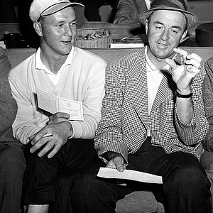 Arnold Palmer, left, and Sam Snead rehash their third round play in the Masters Golf Tournament at the Augusta National Golf Club in August, Ga., April 5, 1958. Palmer and Snead wound up in a tie for the lead with a 54 hole total of 211.