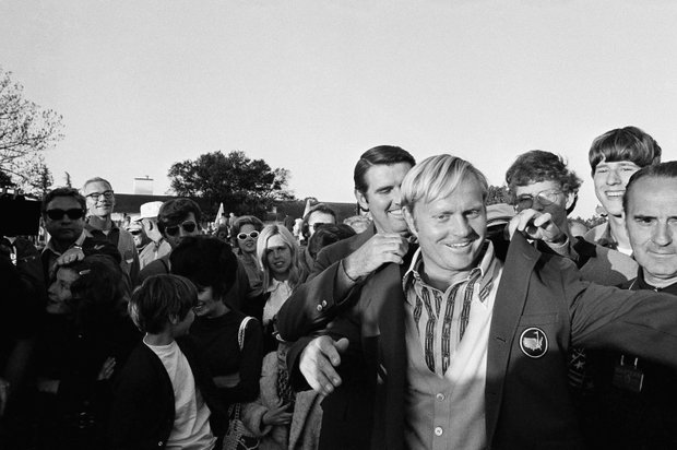 Golfer Jack Nicklaus helped on with his number four Green Coat by Charles Coody, Masters Champion in 1971, after he won his fourth Masters Championship on April 9, 1972 at the Augusta National Golf Club in Augusta, Georgia, USA.