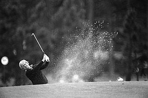 Jack Nicklaus hits from a trap during his practice round for the Masters at Augusta, Ga., April 9, 1975.