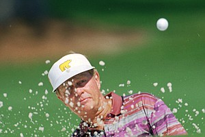 Jack Nicklaus blasts out of the bunker on the seventh hole during the third round of the Masters at the Augusta National Golf Club in Augusta, Ga., Saturday, April 8, 1995.