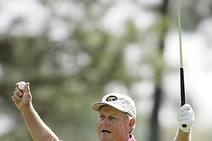 Jack Nicklaus reacts after his birdie on the eighth hole during the second round of the Masters golf tournament at the Augusta National Golf Club in Augusta, Ga., Friday, April 9, 2004.