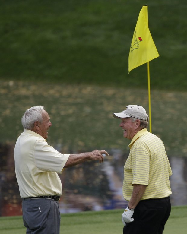Arnold Palmer, left and Jack Nicklaus chat on the ninth hole during the par-3 tournament at the Masters golf tournament in Augusta, Ga., Wednesday, April 7, 2010.