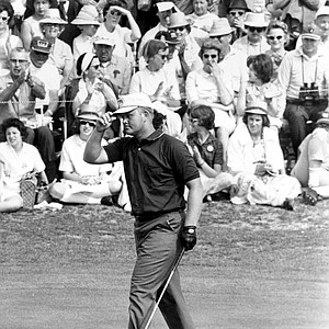 Jack Nicklaus touches his hat after putting out on the 18 in second round of the Masters Golf Tournament at Augusta National Golf Club in Augusta, Ga., on April 5, 1963. The 23-year-old went on to defeat Tony Lema with a score of 286.