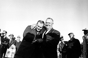 Jack Nicklaus, left, gets a big hug from his father, Charles Nicklaus, after winning the Masters Golf Tournament in Augusta, Ga. on April 7, 1963.