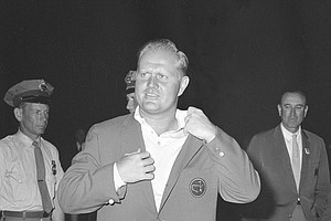 Jack Nicklaus sports the traditional green coat after winning the Masters Tournament at Augusta, Ga., April 11, 1966. (AP Photo)