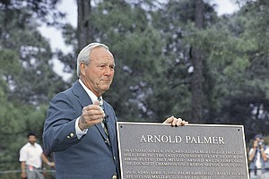 Golfing legend Arnold Palmer is presented with a plaque at Augusta National Golf Club in Augusta, Ga., as Arnold Palmer Day was celebrated on Tuesday April 4, 1995. The day marks the 40th anniversary of Palmer's first appearance at the Masters.