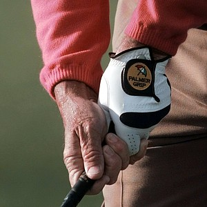 Arnold Palmer grips his club with his signature glove on the first tee at the start of second round of Masters play Friday, April 11, 1997, at the Augusta National Golf Club in Augusta, Ga.