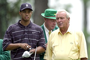 Tiger Woods, left, and Arnold Palmer, right, get ready to tee off during the Par 3 Contest at the Augusta National Golf Club Wednesday, April 10, 2002, in Augusta, Ga.