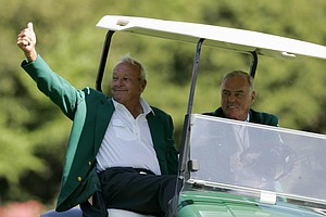 Arnold Palmer, left, gets a ride in the cart on the 12th hole during practice for the 2006 Masters golf tournament at the Augusta National Golf Club in Augusta, Ga., Tuesday, April 4, 2006.