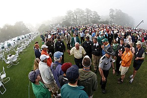 Honorary starter Arnold Palmer, followed by Augusta National Chairman Billie Payne, green jacket, walks through the crowd after teeing off to start the first round of the 2008 Masters golf tournament at the Augusta National Golf Club in Augusta, Ga., Thursday, April 10, 2008.