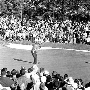 Arnold Palmer makes his final putt before his victory at the Masters Golf Tournament in Augusta, Ga., on April 10, 1960.