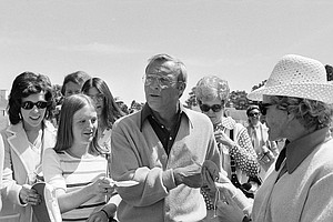 Four-time Masters champion Arnold Palmer is surrounded by women seeking autographs, April 7, 1975 in Augusta, Ga., as he arrives for practice for the Master Championship which begins Thursday in Augusta.