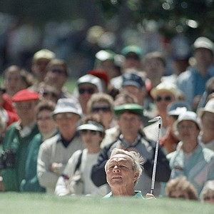 Arnold Palmer, a four-time-winner of the Masters, stretches to watch the ball after hitting from the sandtrap on number one hole during opening round of the Masters at the Augusta National Golf Club, April 7, 1988.