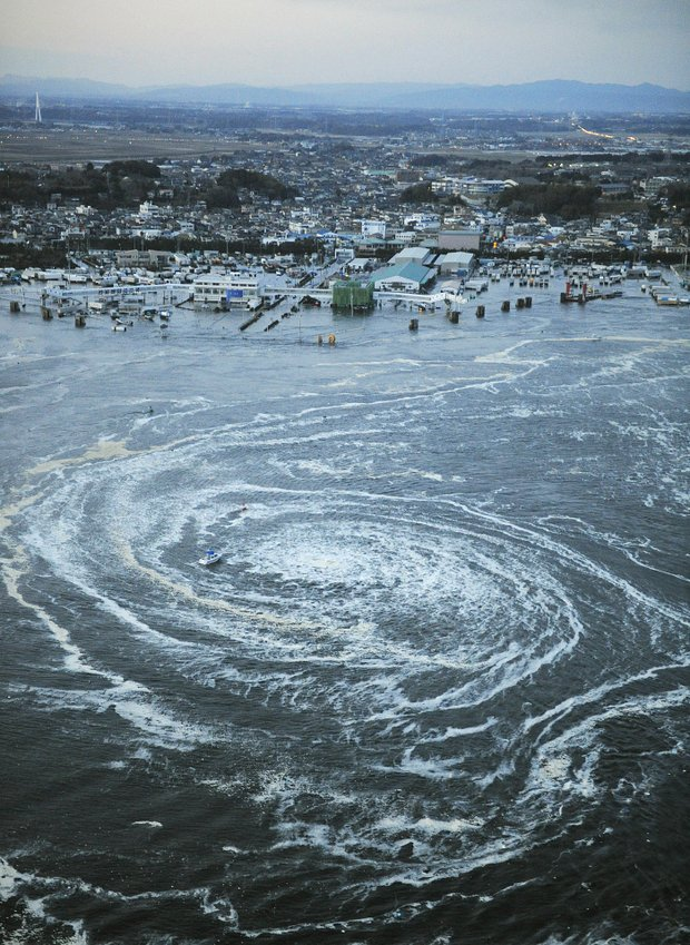 Tsunami waves swirl near a port in Oarai, Ibaraki Prefecture (state) after Japan was struck by a strong earthquake off its northeastern coast Friday, March 11, 2011.