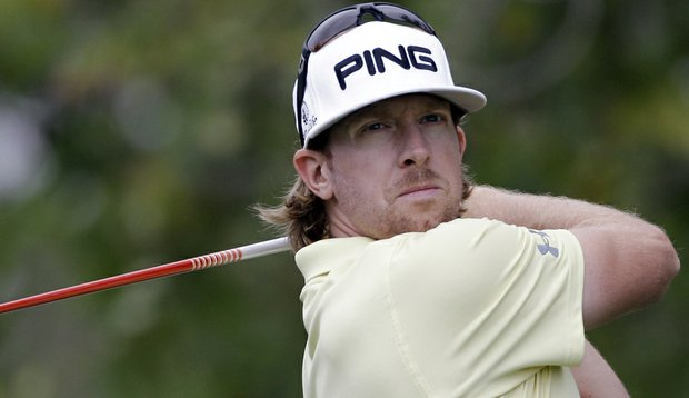 Hunter Mahan hits a shot during the first round of the Cadillac Championship.