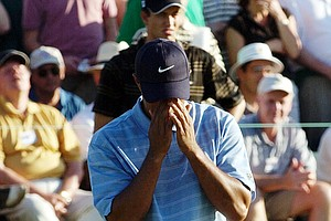 Tiger Woods reacts to a missed birdie putt to finish the round on the 9th hole during third round play of the 2003 Masters at the Augusta National Golf Club in Augusta, Ga., Saturday, April 12, 2003.